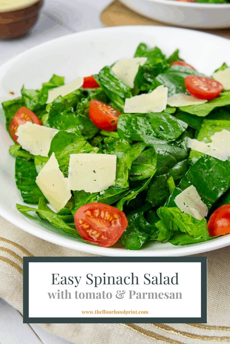 A quick and easy dinner salad of spinach and tomatoes with freshly shaved parmesan cheese and a light vinaigrette. #dinnersalad #sidesalad #sidedish #spinachsalad #spinach #theflourhandprint