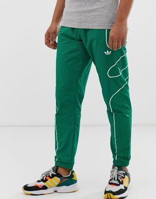 Зеленые джоггеры adidas Originals flamestrike   Мода