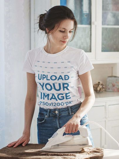 Placeit - T-Shirt Mockup Featuring a Woman Ironing at Home