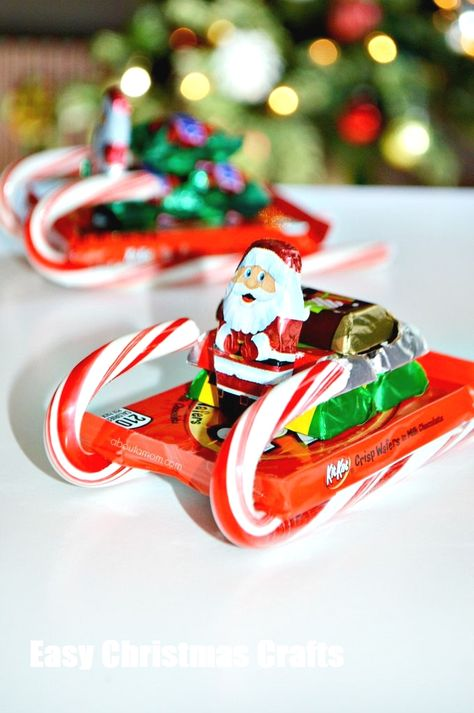 How to Make Candy Sleighs - About A Mom - It is easy to be tempted by sweets during the holidays season. Learn how to make a fun candy sleigh and get tips from the National Candy Association for how to enjoy candy in moderation this holiday season. Christmas Candy Crafts, Candy Cane Crafts, Homemade Christmas Gifts, Christmas Projects, Holiday Crafts, Holiday Fun, Christmas Holidays, Christmas Decorations, Christmas Ideas