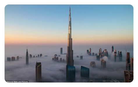Rising about the clouds: The world's tallest building peaks above the mist as Dubai's skyscrapers are dwarfed by stunning sea of fog