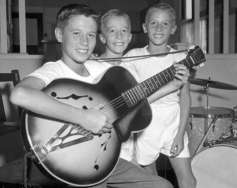 the bee gees. barry grew up to be the most handsome man in the world, and one of the most talented. love their harmonies.