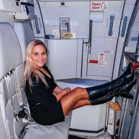 Female Flight Attendant in black leather dress