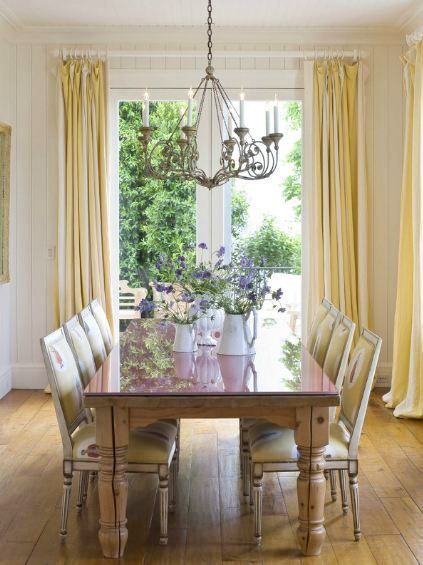Silk panels frame the french doors. The white hardware blends into the background.