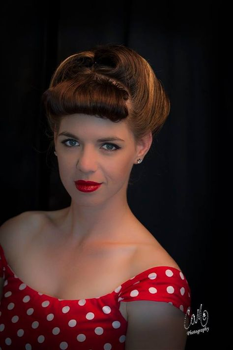 Our Model looking beautiful in Vintage dress and hair.  High placed Victory Rolls help give this forties style its unique look. Hair was roller set to create the curl and then combed up into this lovely up-style that is perfect for weddings, parties or even a night out.