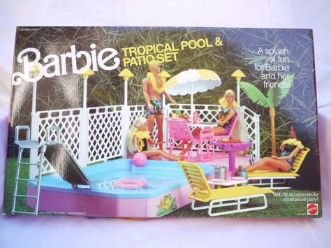 """Barbie Tropical Pool and Patio Set (1986) by Mattel. $199.99. Set includes: Pool slide, 2 chaise lounges, beach ball, palm tree, barbecue, snack table, life preserver, 2 chairs, umbrella and table, 4 plates. 4 knives, 4 spoons, 2 trays, cups, pitcher, pail, drinks, fruit, mustard, ketchup, pretend food, barbecue utensils, pool, fencing and """"lights""""."""