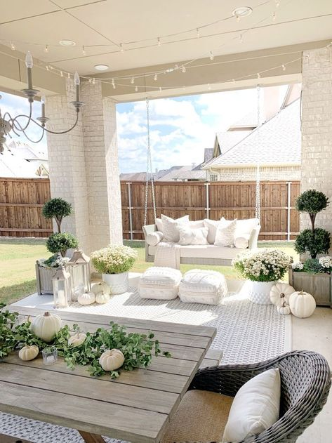 Aug 31, 2020 - Create a beautiful and functional patio space with the addition of affordable decor. We just added this hanging swing to our backyard patio.