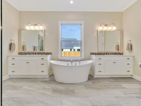 master bathroom with separate vanities and a freestanding