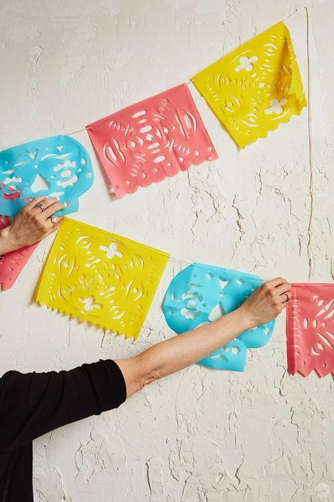 Download three free templates for DIY papel picado: Colorful cut tissue paper banners displayed on Day of the Dead altars and at Mexican celebrations.