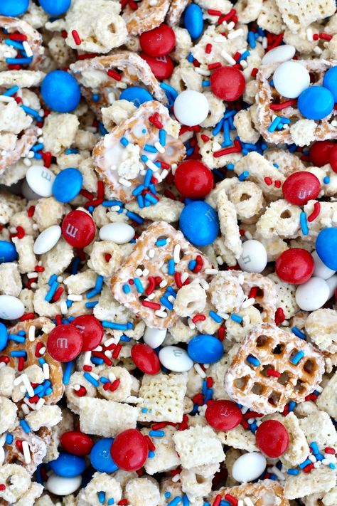 best sweet and salty snack mix ever gets a patriotic pop with red, white and blue M&M's and sprinkles. Always a huge hit!The best sweet and salty snack mix ever gets a patriotic pop with red, white and blue M&M's and sprinkles. Always a huge hit! Patriotic Desserts, 4th Of July Desserts, Fourth Of July Food, 4th Of July Celebration, Patriotic Party, 4th Of July Party, Memorial Day Desserts, Patriotic Crafts, Fourth Of July Recipes