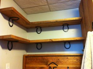 Corner shelves with horseshoe shelf brackets.