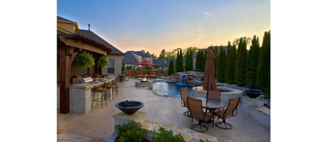 An outdoor kitchen AND beautiful pool?? Yes please!!! Someday...