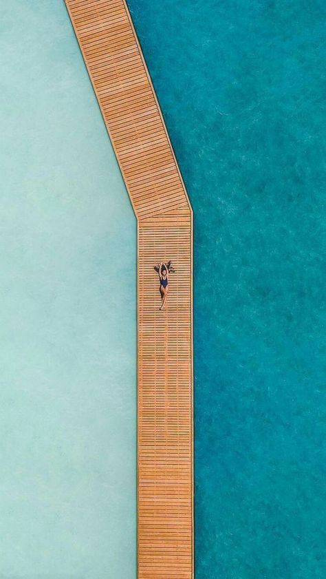 Drone Photography Inspiration | Woman lying on a tropical dock