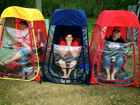 covered chairs, these ladies are at their kids baseball game