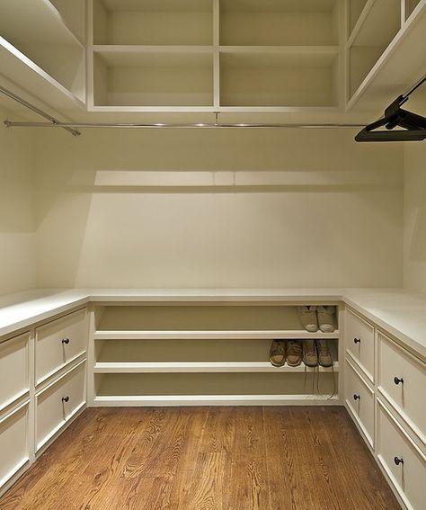 master closet. shelves above, drawers below, hanging racks in middle