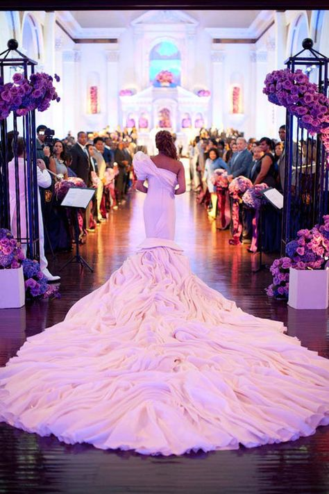 Wow, love the purple decor and the train of her gown.