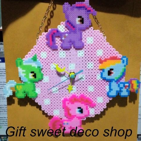 MLP clock hama perler beads by gift_sweetdeco Is the one on the Left a fan pony? I don't recognize it