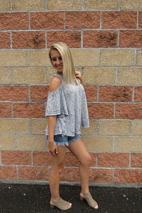 - grey short sleeve cold shoulder lace up top - very comfy & easy to pair with our Medium Washed Cut Offs or Jeans! - model is wearing a small, runs true to size!