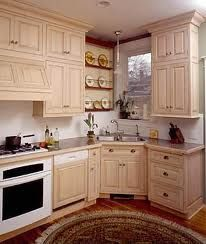 Small Kitchen With Tall Cabinets, Appliance Garage, And Slide Out Cutting  Board. Corner Kitchen Sink ...