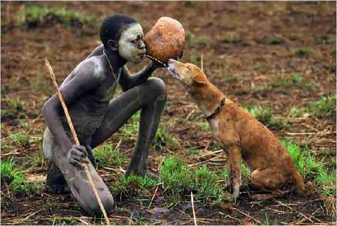 central african hunter and dog.  One way to share a drink of water with your best friend!
