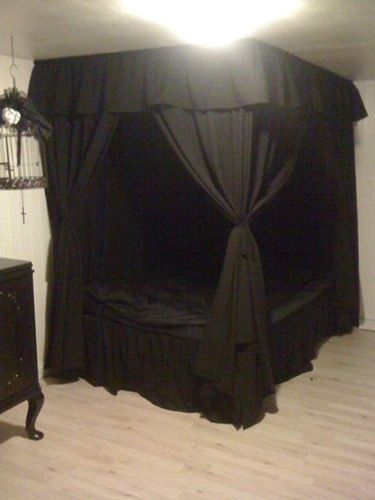 My bed after I hung the homemade canopy and sheer curtains on the curtain  rods. I love my idea because I couldn't find a black canopy anywhere.