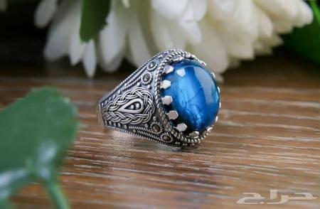 تفسير رؤية خاتم بفص ازرق تفسير حلم خاتم فضة رجالي Turquoise Ring Gemstone Rings Gemstones