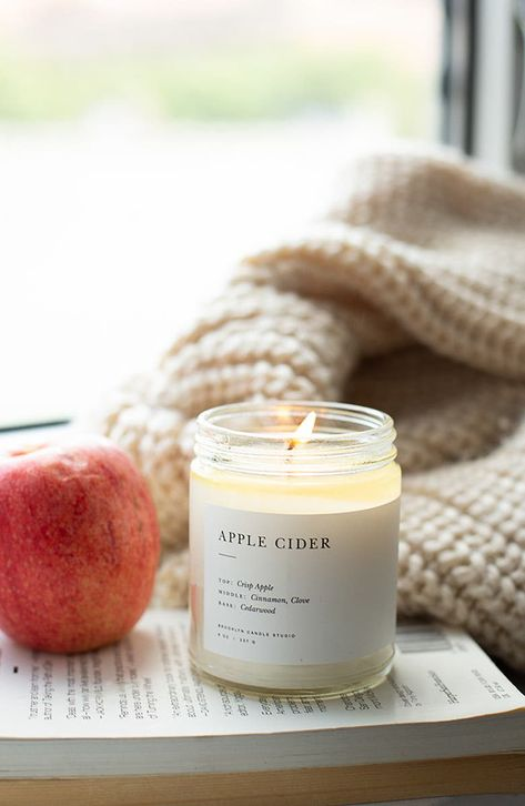 An elegant soy candle—presented in a glass vessel with a minimalist label—fills any room in your home with scent.