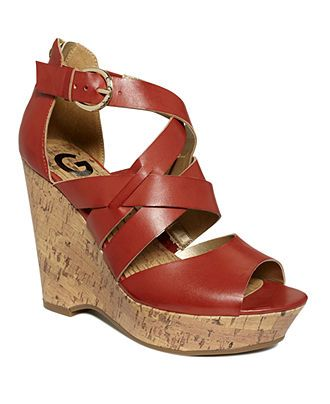 Guess Passage, Orange Red.... so comfortable....mine, new for spring.  Hurry Sandal season, so I can wear them