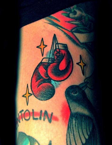 Anyone who loves boxing can appreciate these boxing gloves tattoos.