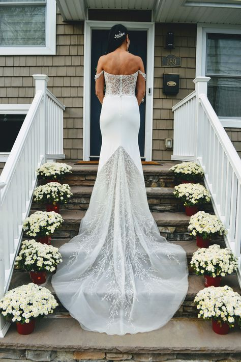 Bride wears an off the shoulder crepe and beaded wedding dress by Enaura bridal to her backyard micro wedding in New York.