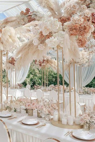 Pampas Grass Wedding Ideas for the Boho Glam Bride Luxury Pink and gold long wedding tablescape with hanging floral decor and tall wedding centerpieces Blush Centerpiece, Tall Wedding Centerpieces, Floral Centerpieces, Wedding Reception Decorations Elegant, Quinceanera Centerpieces, Floral Arrangements, Reception Table, Elegant Wedding Colors, Luxury Wedding Decor