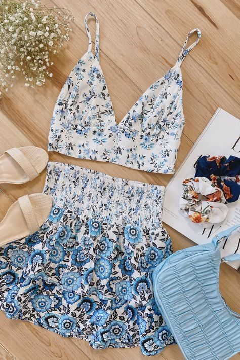 Lulus Exclusive! This summer season, feel the cool vibes of the Lulus Totally Botanic White Multi Floral Print Two-Piece Mini Dress! This cute two-piece dress has a woven challis composition that features two sets of white, blue, and black floral print patterns that shapes a V-neckline, a cropped triangle bodice, and a wide bottom band with smocking at the back, all supported by adjustable spaghetti straps. #lovelulus