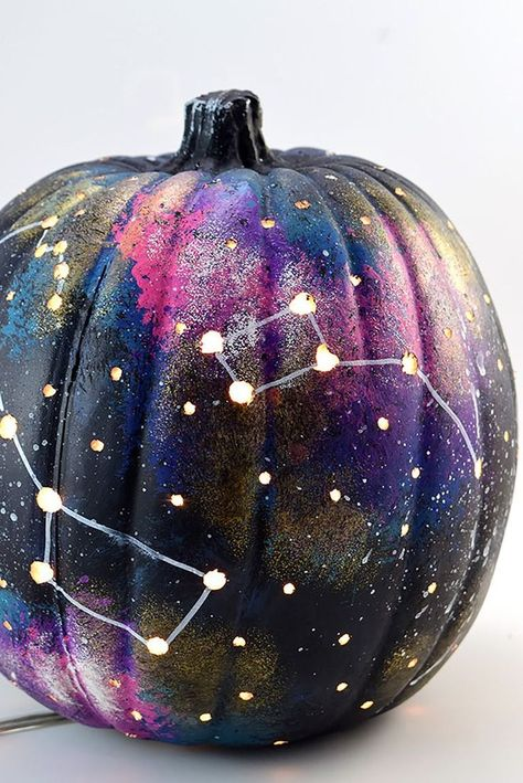 Flicking white paint with a toothbrush is fun, but copying true-to-life constellations really sets this starry galaxy pumpkin apart. Click through to see more of the best pumpkin painting ideas and to get the tutorial!