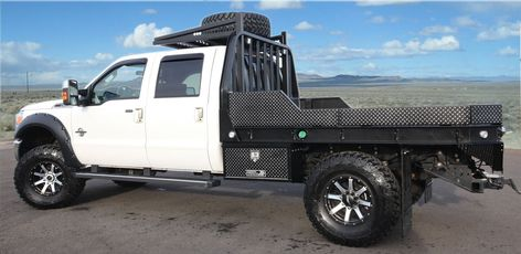 Aluminum flatbed with spare tire riack by Highway Products - Powdercoated black.
