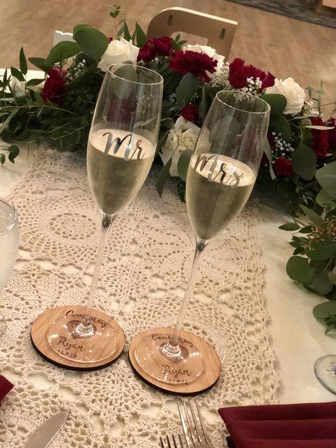 #champagneglasses #personalizedcoasters #mrandmrs #toast #cheers #fallwedding #ronjaworskiweddings #blueheronweddings #lacerunner #red #ivory #sweethearttable #weddings #njweddings #roses #justmarried #ido #weddingcolors #weddingdecorideas #receptionvenue #weddingreception #sweethearttabledecor #headtable #rusticwedding #rusticdecor #toastingglasses #coastalwedding #njcoastalweddings #ballroom #coasters #wood #weddingflowers #flowerideas  #golfcourseweddings #christmaswedding #winterwedding