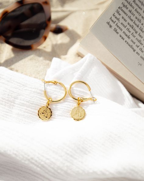 Photography ideas, jewellery flat lay, on the beach, sunlight