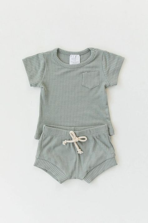 These comfy Mebie Baby pocket tee and short sets are made out of a soft ribbed fabric and a faux tie on the shorts. Color: Sage Runs true to size Fabric: Rayon Spandex Care: Wash in cold water. Cute Baby Boy Outfits, Cute Baby Clothes, Kids Outfits, Cool Outfits, Baby Boy Style, Clothes Swag, Trendy Baby Boy Clothes, Unisex Baby Clothes, Girl Style