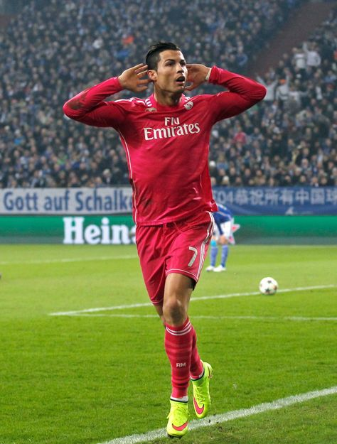 Cristiano Ronaldo of Real Madrid celebrates after scoring his team's first goal during the UEFA Champions League round of 16 first leg match between Schalke 04 and Real Madrid CF at Veltins-Arena on February 18, 2015 in Gelsenkirchen, Germany.