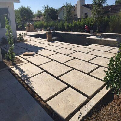 QDI Surfaces Nysa Tumbled Travertine Paver in Tan