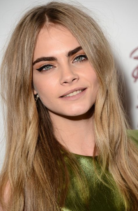 Cara Delevingne- dark eyebrows and dark blonde hair.