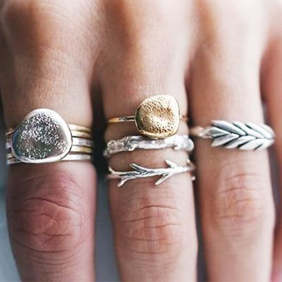 delicately layered rings. Love the mixing of gold and silver, two tone looks fabulous.