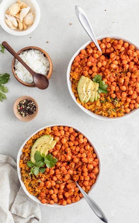 My mama's delicious vegetarian Puerto Rican inspired recipe: chickpeas in sofrito served with arroz con gandules (rice with pigeon peas). Delicious and packed with plant-based protein! This recipe is sponsored by BUSH'S® Beans. #sofrito #puertoricanfood #vegetarian #healthydinner #dinnerideas #veganrecipe #vegan