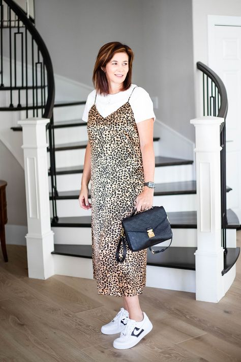 Lady in & Other Stories leopard slip dress with One Twelve sneakers and Louis Vuitton Purse. #fallstyle #fallfashion #falltrends #over40fashion #over50fashion #fashionover50 #fashionover40 #styledahlia