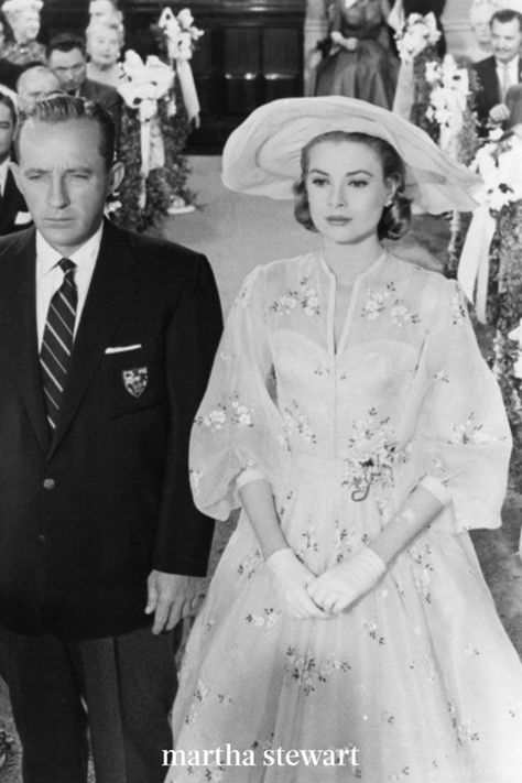 Looking for a little floral wedding dress inspo? Turn to the dress Grace Kelly wore as Tracy Samantha Lord to marry Bing Crosby's character, C.K. Dexter Haven, in the 1956 remake of The Philadelphia Story. And that hat! So very sweet and iconic. The designer behind the bridal look? None other than Helen Rose, who created Kelly's own wedding dress. #weddingideas #wedding #marthstewartwedding #weddingplanning #weddingchecklist