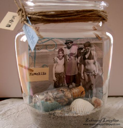Sand, shells, and a picture from your beach trip in a jar....(kinda looks like a scrapbook page in a jar :)