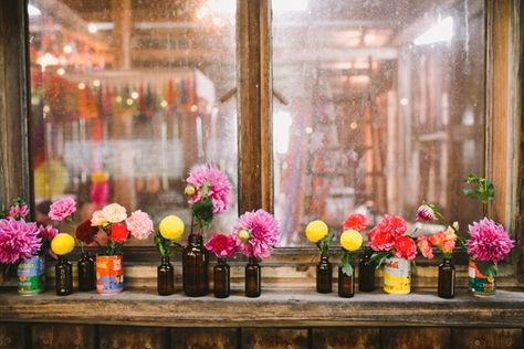Single flowers in vintage tins and bottles