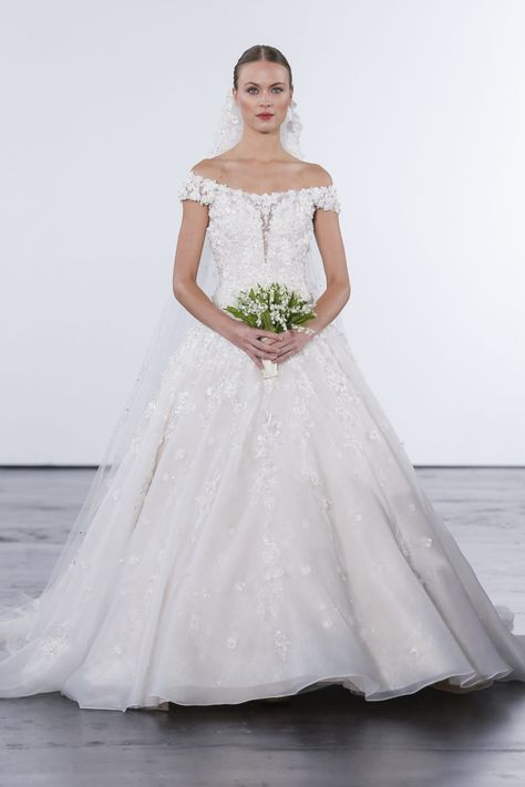 64ae5aef602 Off-the-shoulder dropped waist ball gown with beaded lace bodice and  organza floral appliqués.