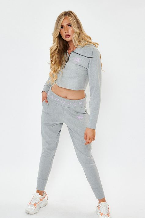 Our first zanouchi womenswear tracksuit! Light, comfy and supersoft on your skin, it has all the key elements for what you need. Feminine yet street an effortlessly stylish outfit combo that can be used to lounge in or out about. A must have for this seasons wardrobe Sizing & Styling Selection: Style: Funnel Neck Sweat and Jog Pant Fit Type: Regular Fit Body Fit: Fit true to size. Abigail wears size 10 and is 5ft 9. Fabric Composite: 95% Cotton 5% PES Pattern: Zipped Cropped Sweat Dress, Fun