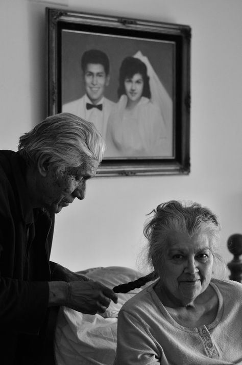 Years & Tenderness How cute, he is braiding her hair. Notice the portrait in the background! Awesome photo.