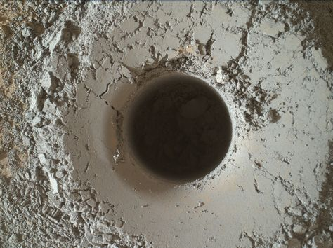 Nice new drill hole by Curiosity at the Mojave2 drill site in Pahrump Hills. The smooth areas kind of look like plaster or cement. :-)